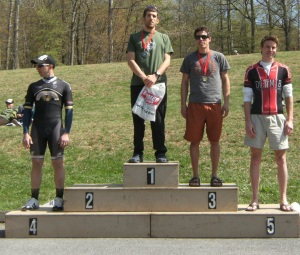 Podium with top five racers; Alex at the top center.  Second place rider is absent.