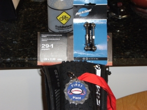 Bike Lane water bottle, Park Tools multitool, Bontrager tire, first place medal