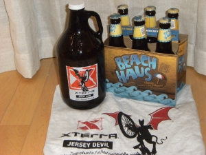 T-shirt, growler, six-pack of Beach Haus beer
