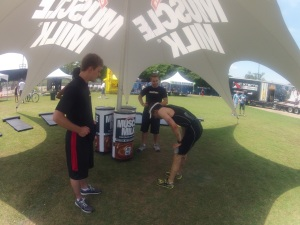 Alex in the Muscle Milk tent with two Muscle Milk reps.