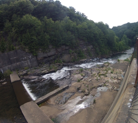 A view from the top of Yellow Creek dam, water and rocks below