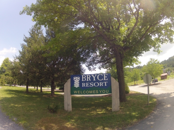 Bryce Resort Welcome Sign next to the resort entrance road
