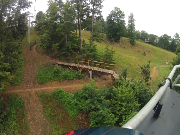 A black diamond ramp with another trail underneath, as seen from the ski lift