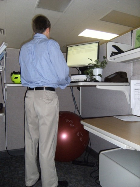 Alex standing at his standing desk