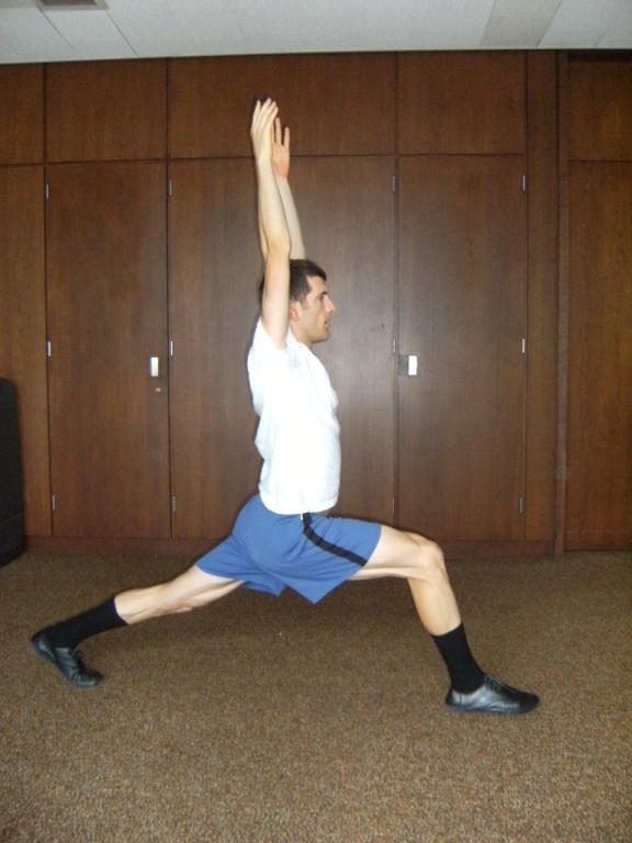 Alex in warrior one yoga position
