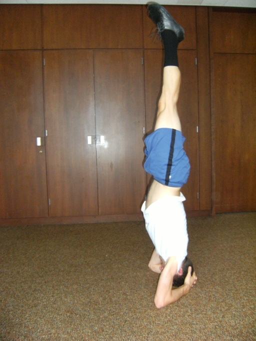 Alex in a head stand yoga position
