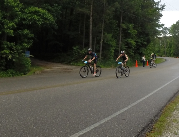 Riding fullbore on the park road, with the forsest on our right and race officials looking on from behind