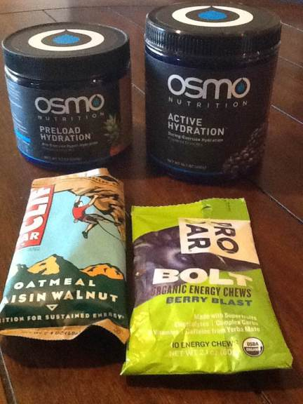I put OSMO in my bottles and eat small bites of cliff bars towards the beginning of the bike. I use PRO BAR Bolt energy chews on run and latter part of the bike.