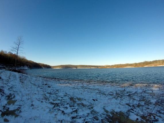 Snow covered lake beach.