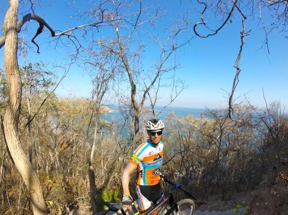 Josiah Middaugh with his Felt mountain bike, overlook of the ocean.