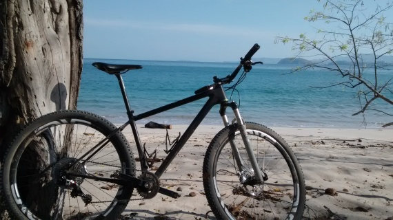 Open O-1.0 mountain bike, chillin on the beach at Reserva Conchal.
