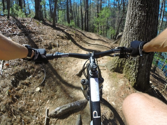 First-person point of view, mountain bike rider on Open O-1.0 on the trail at Kerr Scott Dam.