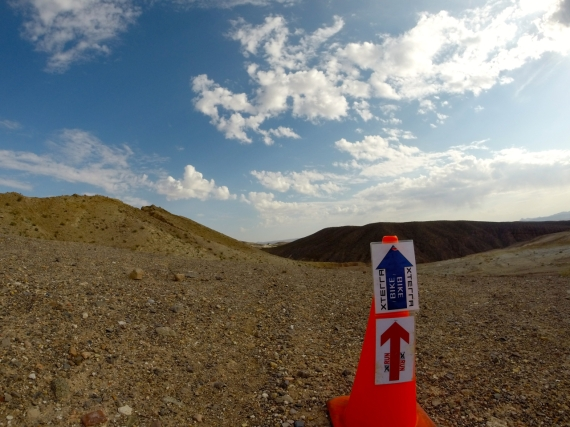 Xterra off-road triathlon race course arrows pointing into the desert trail.